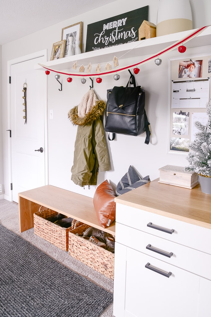 mudroom decorated for christmas