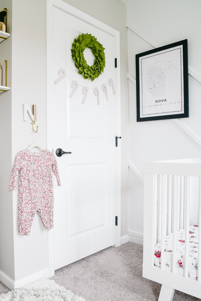 nursery closet door decorated for Christmas with a wreath and garland