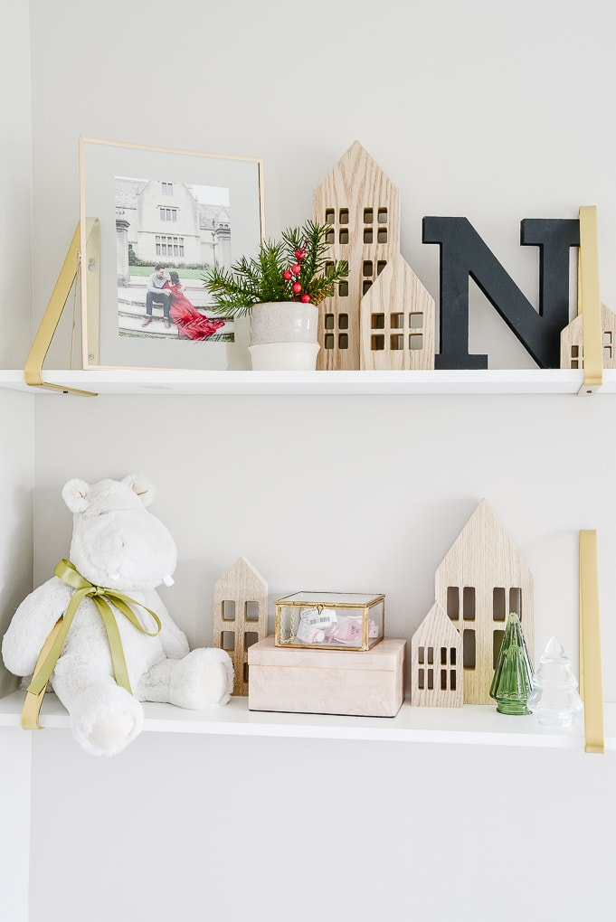 decorated white and gold shelves for Christmas in nursery
