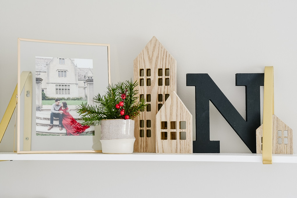 natural wooden houses from target on decorated christmas shelves
