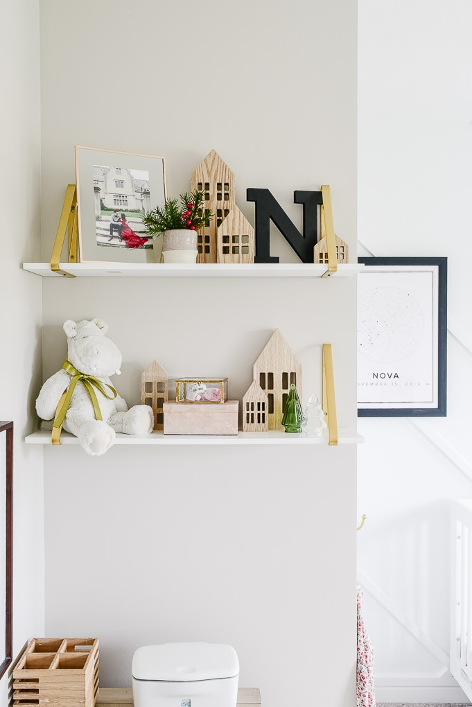 white and gold shelves in a nursery decorated for Christmas