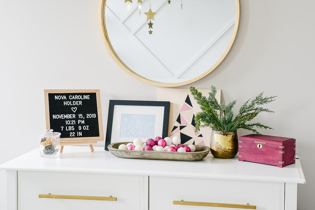 details on a nursery dresser decorated for Christmas