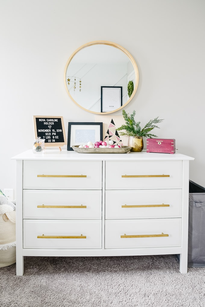 white dresser in nursery decorated for Christmas