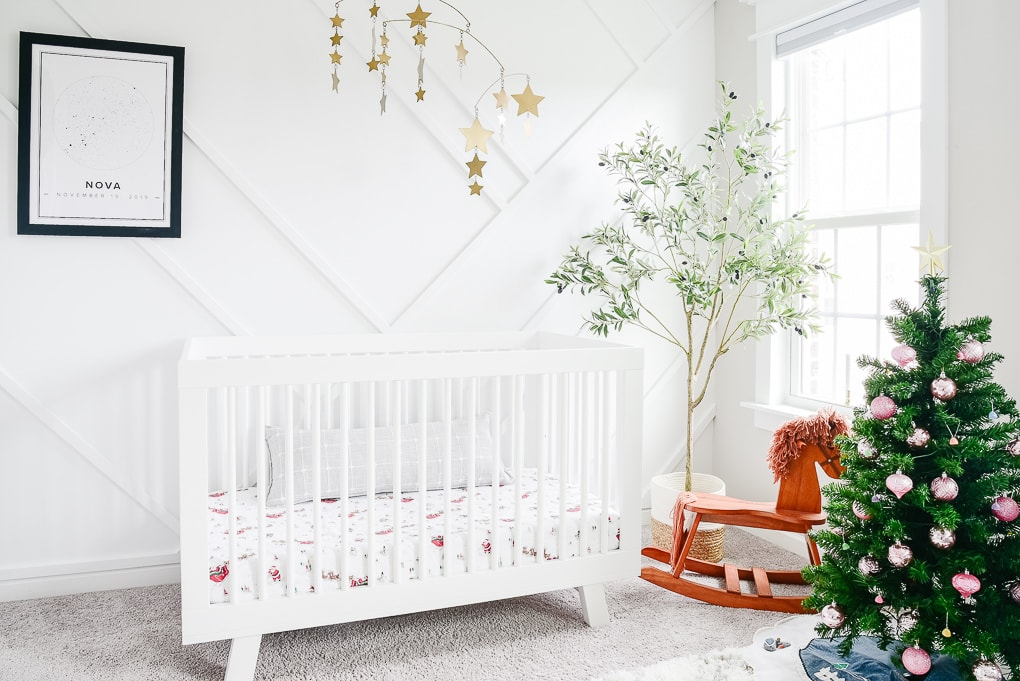 white nursery decorated with a kids tree for Christmas