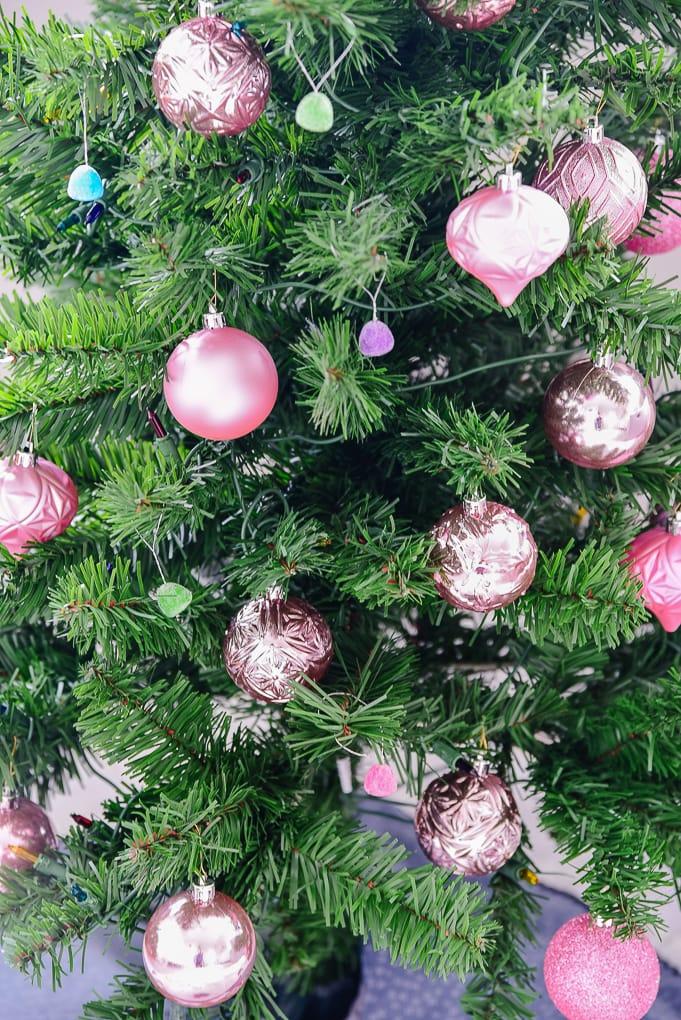 pink shatterproof ornaments on Christmas tree