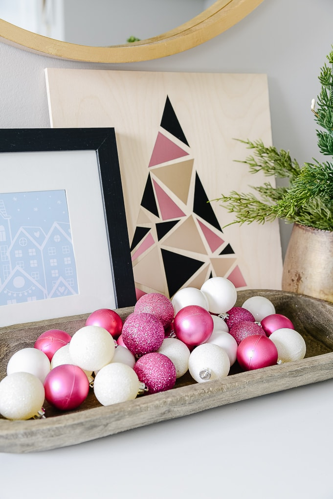 pink and white ornaments in a tray christmas decor