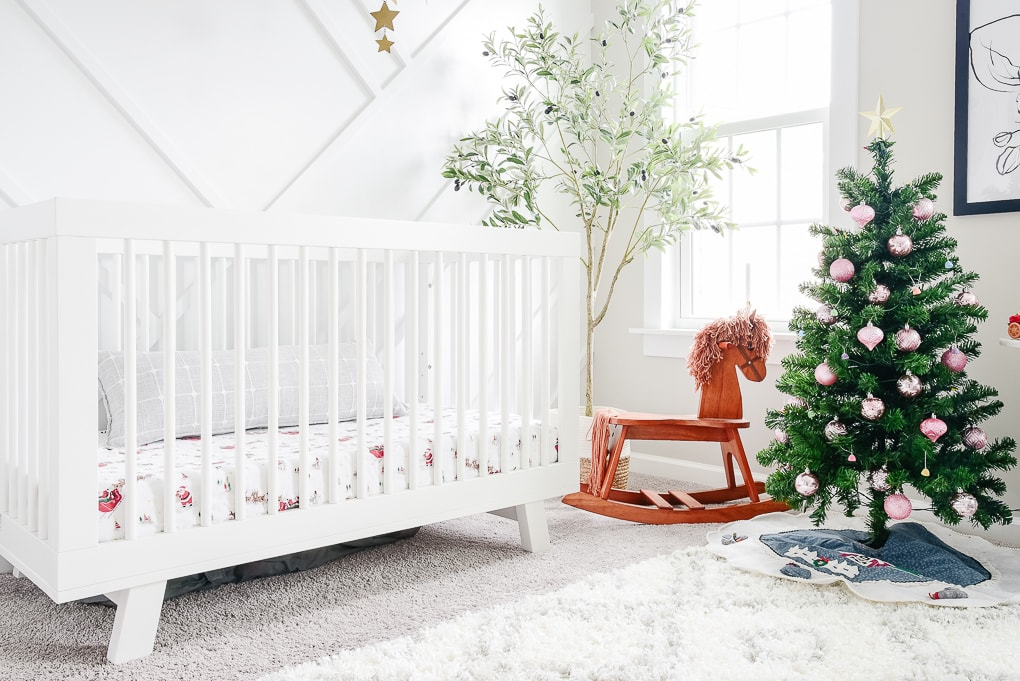 bright nursery decorated for Christmas small decorated Christmas tree