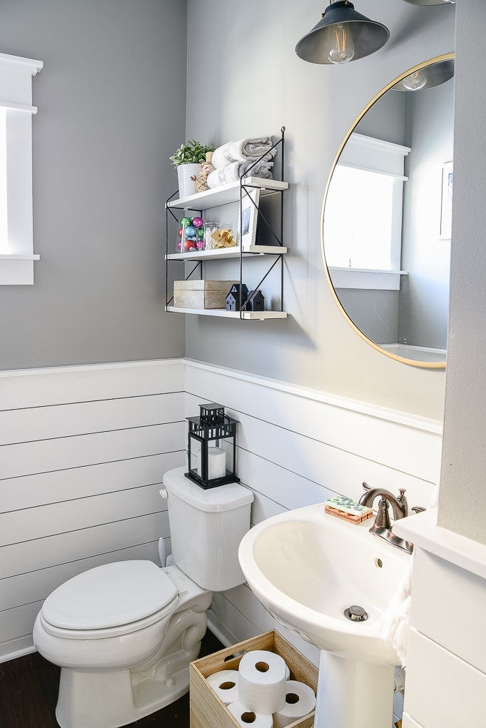simple clean powder room with shiplap decorated for Christmas