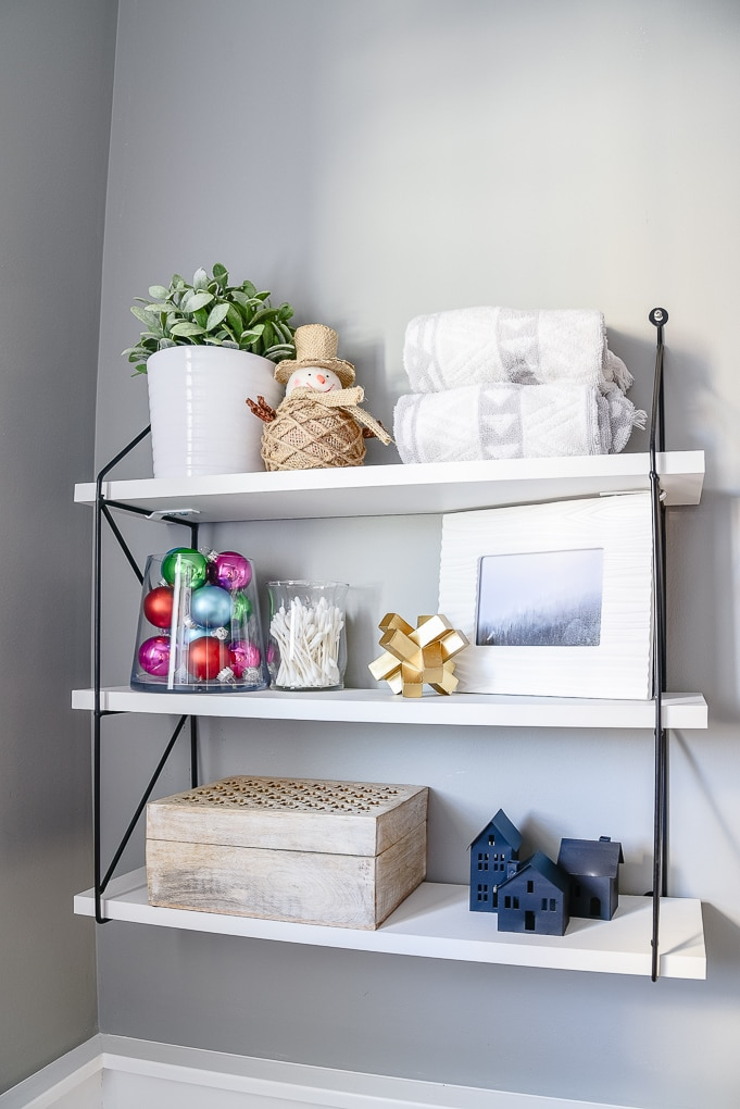 styled decorated shelves in powder room Christmas styling and decor