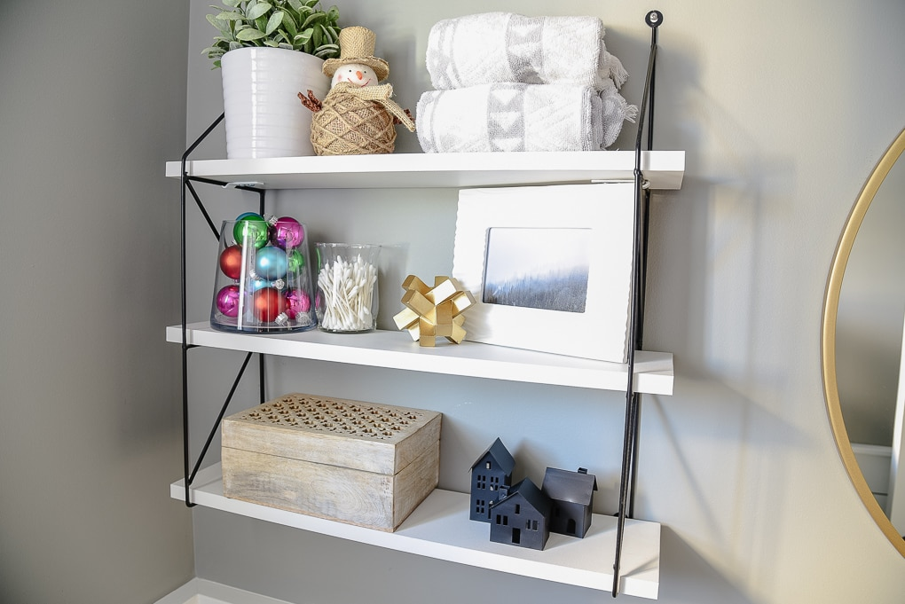 powder room styled shelves decorated for Christmas