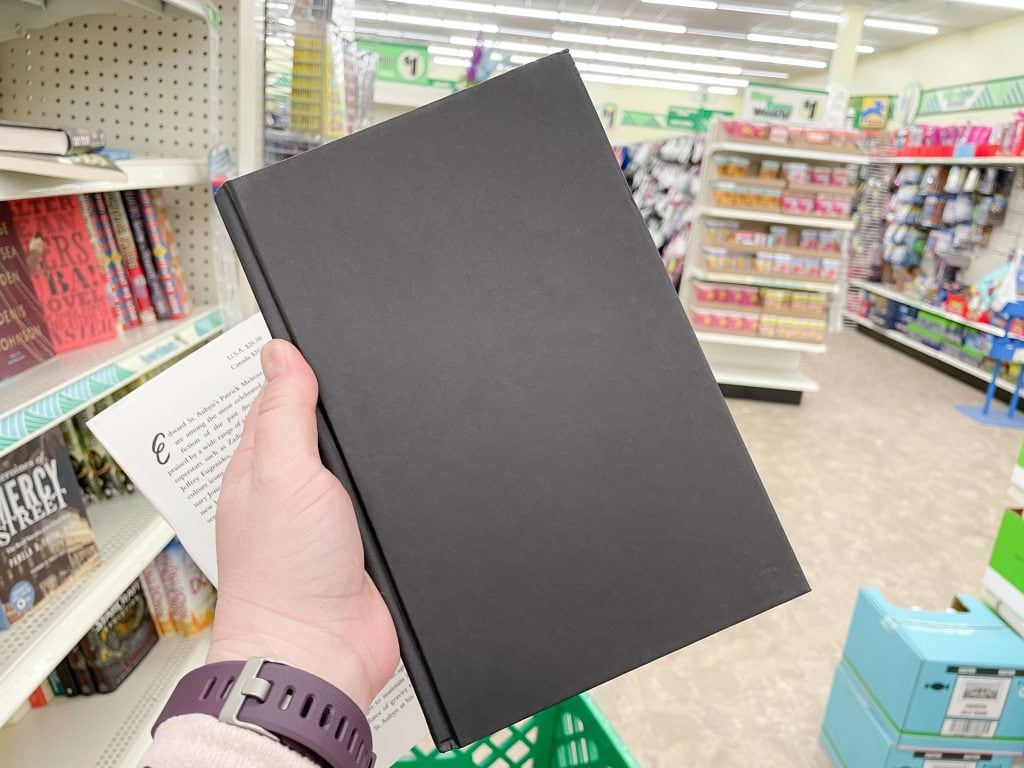black hardcover book from the dollar tree that can be used as a budget home decor book
