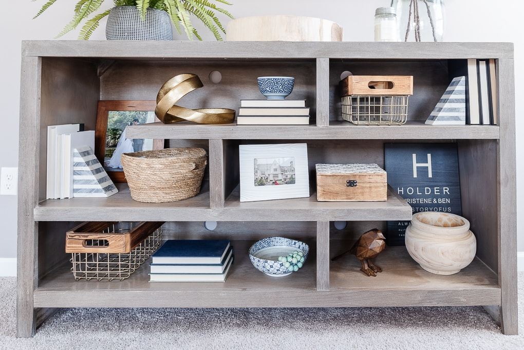 gray shelves with home decor throughout and lots of decorative books