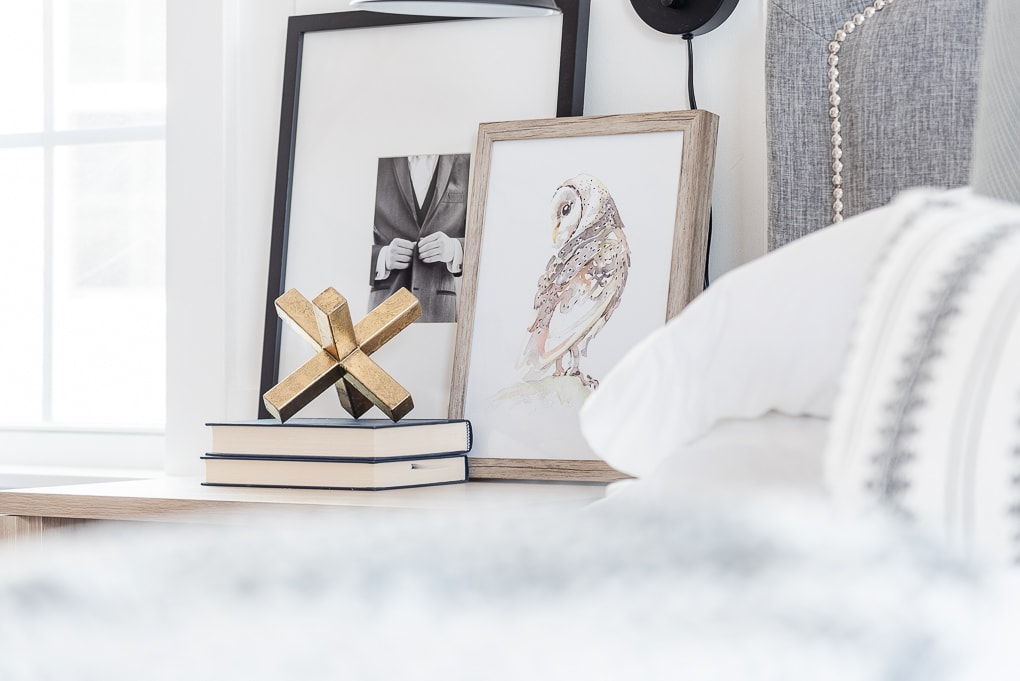 home decor books stacked on nightstand with gold decorative object