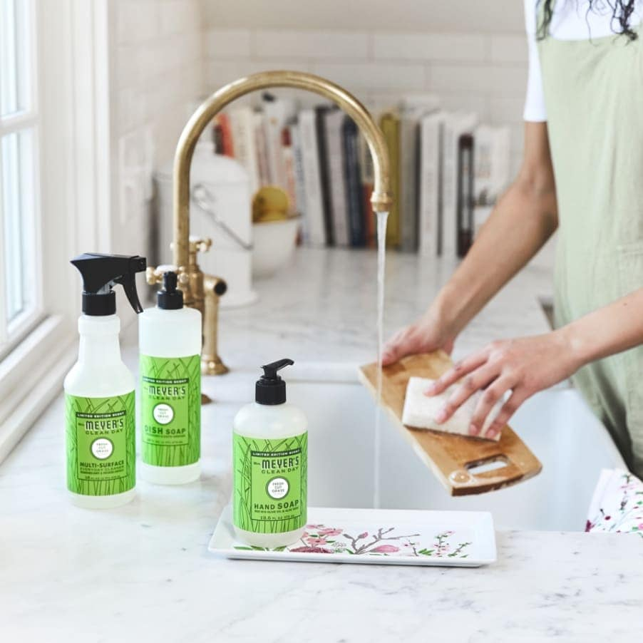 mrs. meyers cleaning products next to kitchen sink cleaning