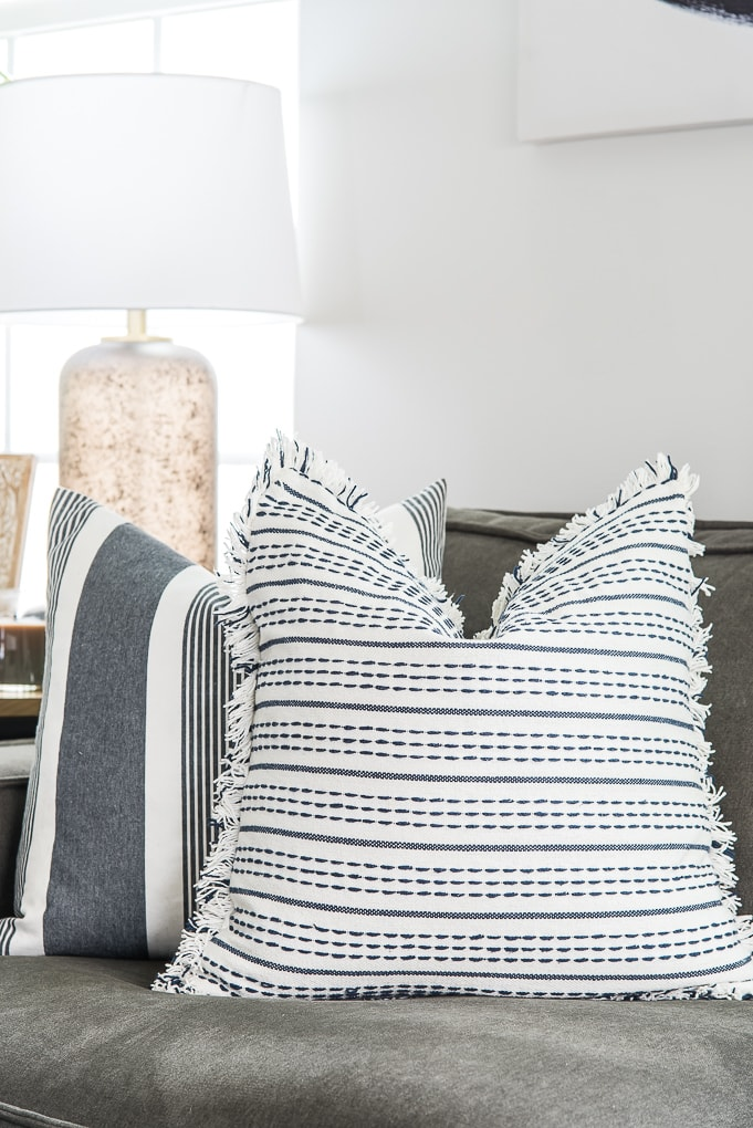 blue pattern pillows on a gray couch