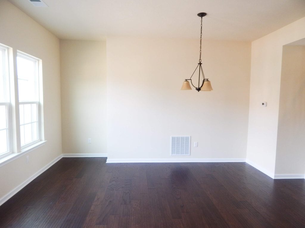 empty dining room in townhome with yellow paint on the walls