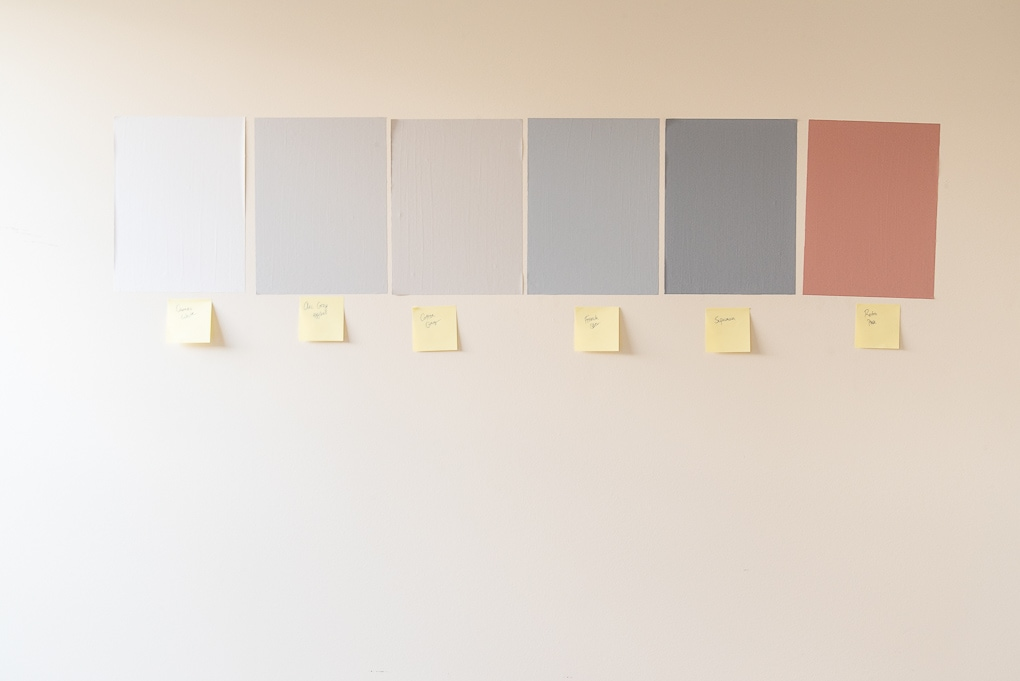 testing paint colors on the wall in diy home decor project
