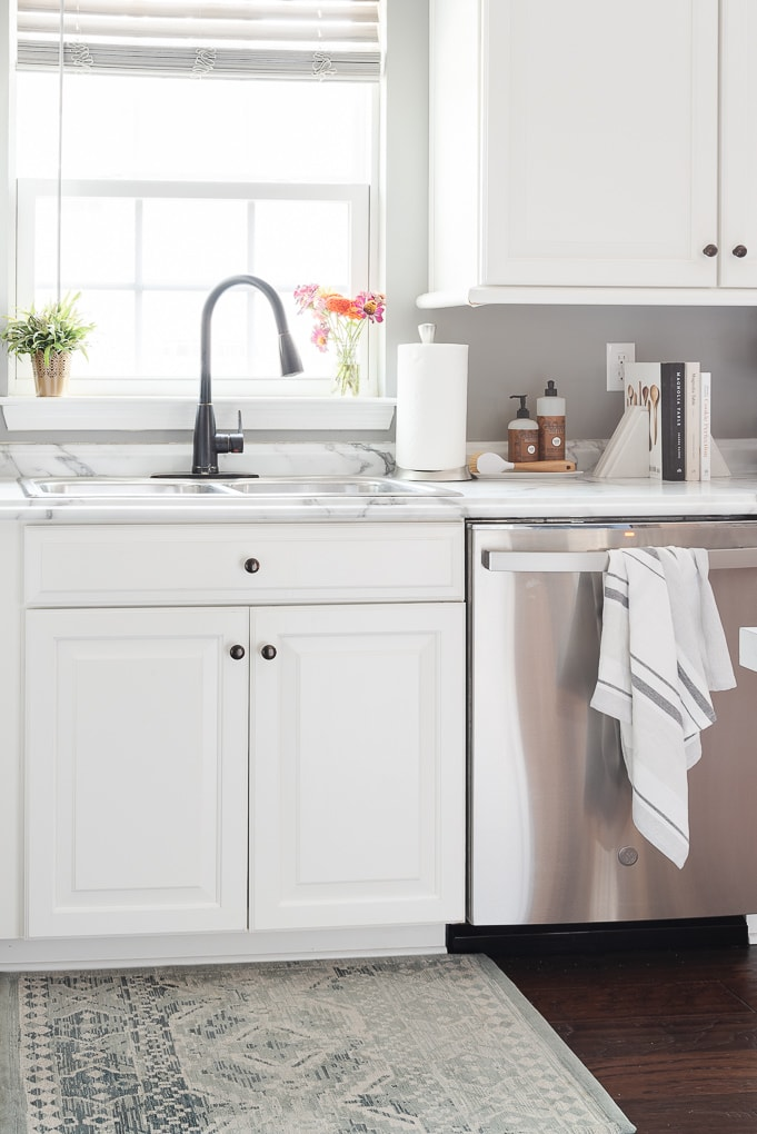 white kitchen cabinets clean kitchen sink and dishwasher stainless steel