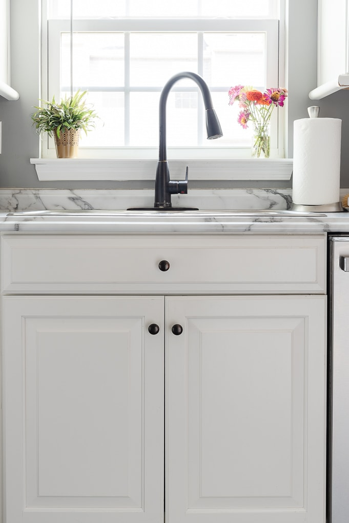 kitchen sink cleaned in white kitchen bright and airy