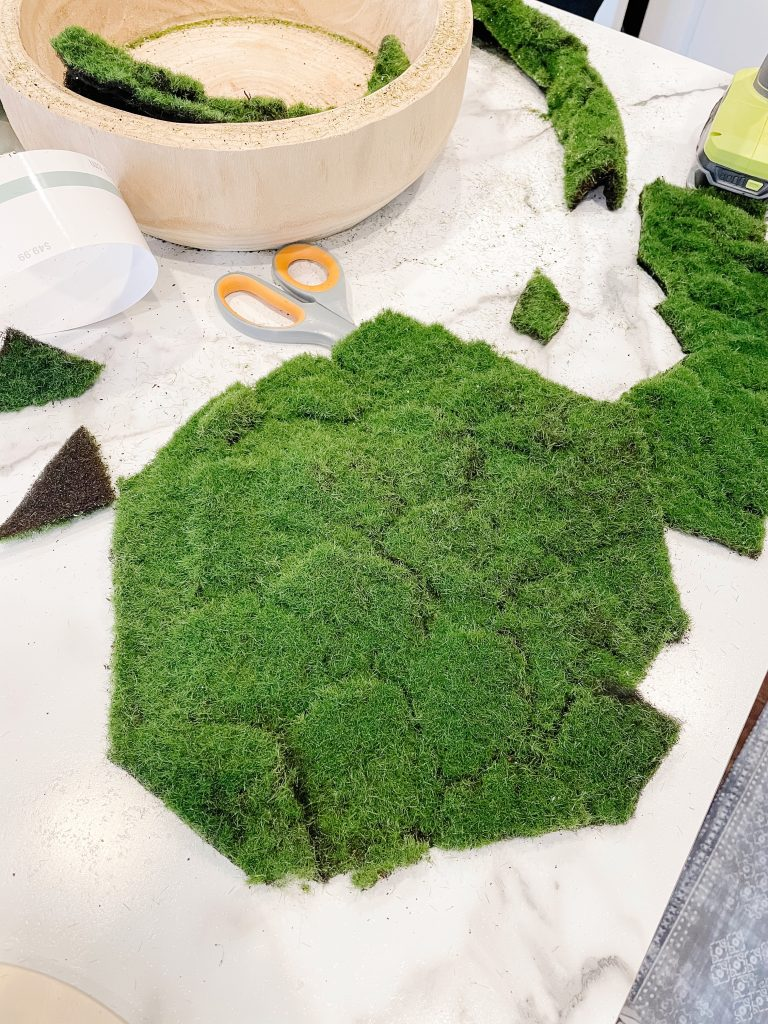realistic looking faux moss sheet cut from a roll for a diy project