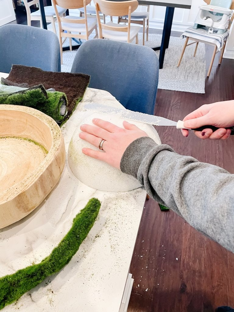 slicing a foam half ball with a knife