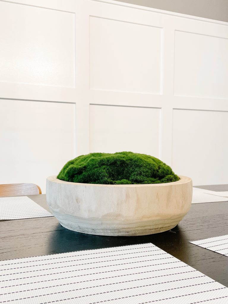 side view of diy moss bowl centerpiece on dining room table
